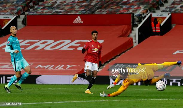 Marcus Rashford of Manchester United scores their side's second goal past Alisson Becker of Liverpool during The Emirates FA Cup Fourth Round match...