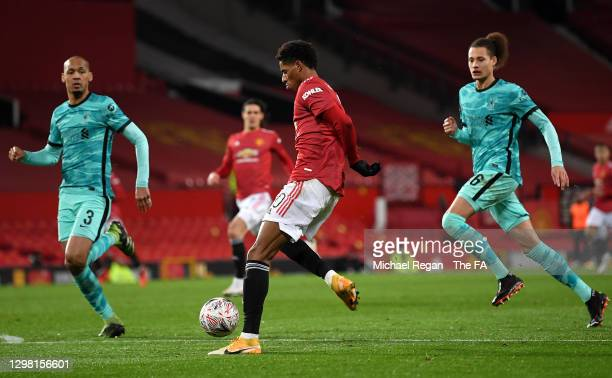 Marcus Rashford of Manchester United scores their side's second goal as Fabinho and Rhys Williams of Liverpool look on during The Emirates FA Cup...