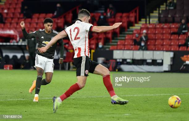 Marcus Rashford of Manchester United scores their sides third goal during the Premier League match between Sheffield United and Manchester United at...