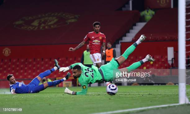 Marcus Rashford of Manchester United scores their team's first goal past Robert Sanchez of Brighton & Hove Albion during the Premier League match...