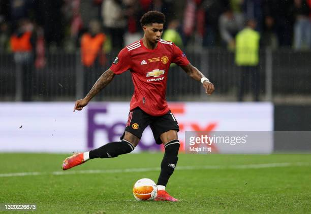Marcus Rashford of Manchester United scores their team's fourth penalty in the penalty shoot out during the UEFA Europa League Final between...