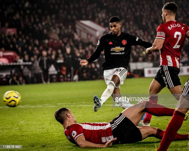 Marcus Rashford of Manchester United scores their third goal during the Premier League match between Sheffield United and Manchester United at...