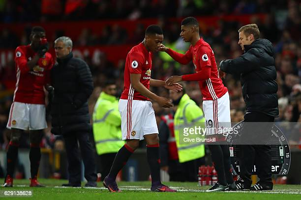 Marcus Rashford of Manchester United shakes hands with Anthony Martial during the Premier League match between Manchester United and Tottenham...