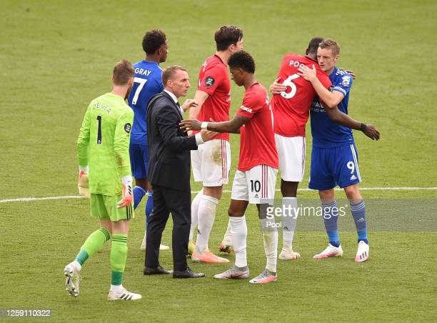 Marcus Rashford of Manchester United shakes hands with Brendan Rodgers Manager of Leicester City after the Premier League match between Leicester...