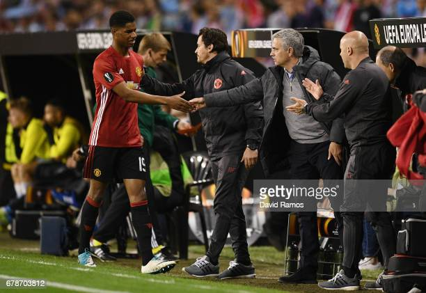 Marcus Rashford of Manchester United shakes hands with Jose Mourinho manager of Manchester United as he is substituted during the UEFA Europa League...