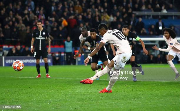 Marcus Rashford of Manchester United shoots and scores his first competitive penalty for Manchester United during the UEFA Champions League Round of...