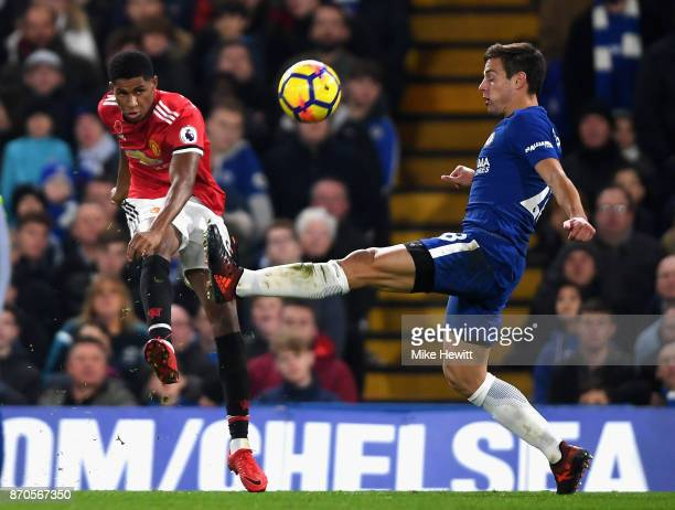 Marcus Rashford of Manchester United shoots as Cesar Azpilicueta of Chelsea attempts to block during the Premier League match between Chelsea and...