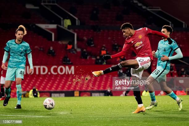 Marcus Rashford of Manchester United shoots during the Emirates FA Cup Fourth Round match between Manchester United and Liverpool at Old Trafford on...