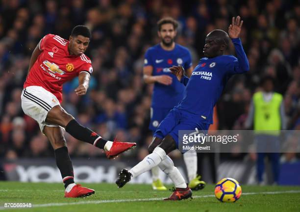 Marcus Rashford of Manchester United shoots while N'Golo Kante of Chelsea attempts to block during the Premier League match between Chelsea and...