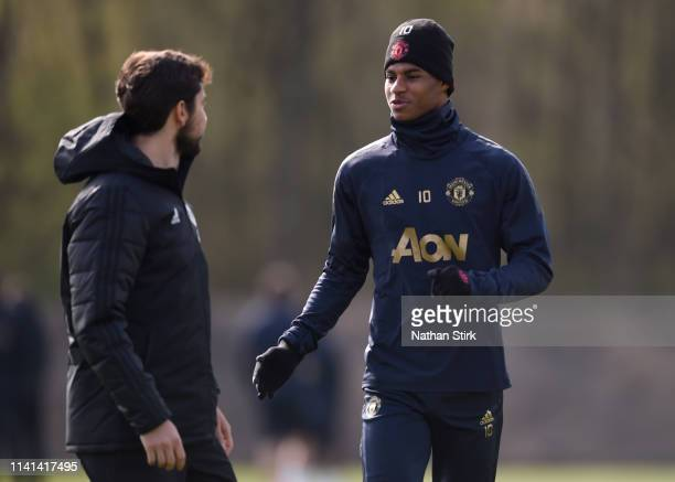 Marcus Rashford of Manchester United speaks to Paolo Gaudino Manchester United fitness during the Manchester United training session ahead of the...