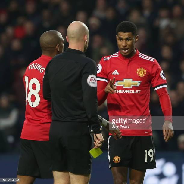 Marcus Rashford of Manchester United speaks to Referee Anthony Taylor during the Premier League match between West Bromwich Albion and Manchester...