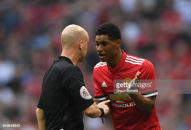 Marcus Rashford of Manchester United speaks with referee Anthony Taylor during The Emirates FA Cup Semi Final match between Manchester United and...