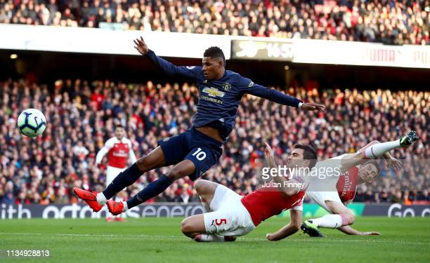 Marcus Rashford of Manchester United stretches for the ball during the Premier League match between Arsenal FC and Manchester United at Emirates...