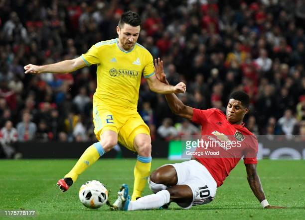 Marcus Rashford of Manchester United tackles Antonio Rukavina of Asanta during the UEFA Europa League group L match between Manchester United and FK...