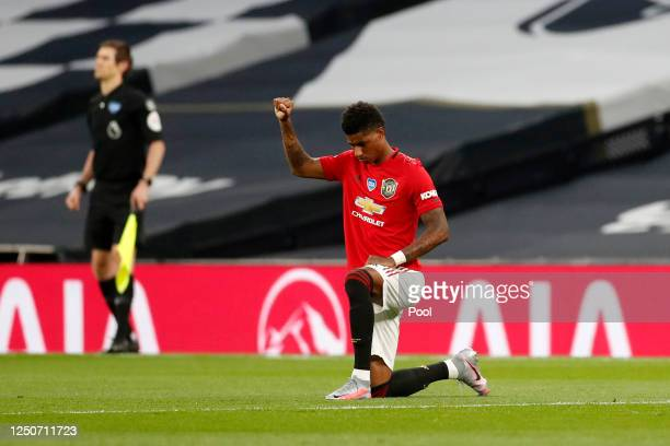 Marcus Rashford of Manchester United takes a knee in support of the Black Lives Matter movement prior to the Premier League match between Tottenham...