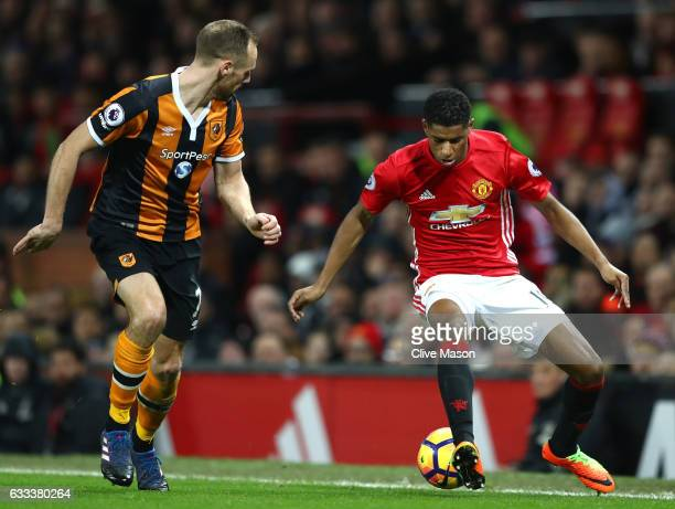 Marcus Rashford of Manchester United takes on David Meyler of Hull City during the Premier League match between Manchester United and Hull City at...