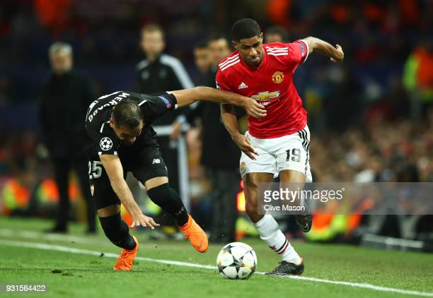 Marcus Rashford of Manchester United takes on Gabriel Mercado of Sevilla during the UEFA Champions League Round of 16 Second Leg match between...