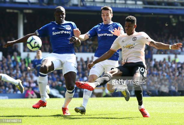 Marcus Rashford of Manchester United takes on Kurt Zouma and Seamus Coleman of Everton during the Premier League match between Everton FC and...
