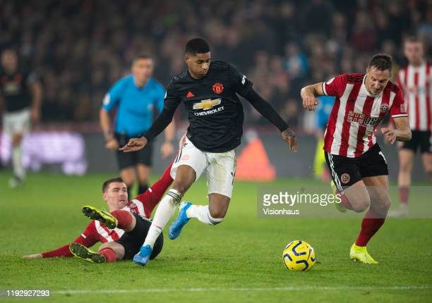 Marcus Rashford of Manchester United takes on Phil Jagielka and John Fleck of Sheffield United during the Premier League match between Sheffield...