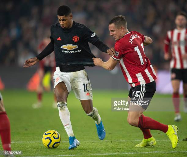 Marcus Rashford of Manchester United takes on Phil Jagielka of Sheffield United during the Premier League match between Sheffield United and...