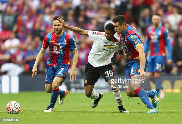 Marcus Rashford of Manchester United takes on Scott Dann and Yohan Cabaye of Crystal Palace during The Emirates FA Cup Final match between Manchester...