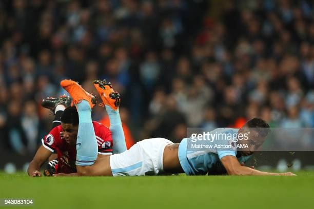 Marcus Rashford of Manchester United tangles with Danilo of Manchester City during the Premier League match between Manchester City and Manchester...