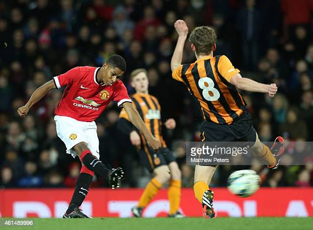 Marcus Rashford of Manchester United U18s in action with Ellis Barkworth of Hull City U18s during the FA Youth Cup Fourth Round match between...