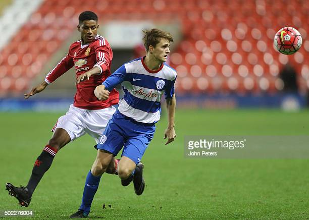 Marcus Rashford of Manchester United U18s in action with Jake Eales of Queens Park Rangers U18s during the FA Youth Cup third round match between...