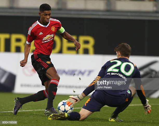 Marcus Rashford of Manchester United U19s in action with Phillip Menzel of VfL Wolfsburg U19s during the UEFA Youth League match between VfL...