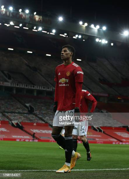 Marcus Rashford of Manchester United walks off at halftime during the Emirates FA Cup Fourth Round match between Manchester United and Liverpool at...