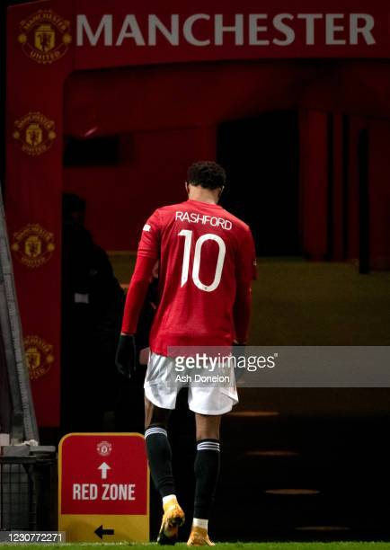 Marcus Rashford of Manchester United walks off at the end of the Emirates FA Cup Fourth Round match between Manchester United and Liverpool at Old...