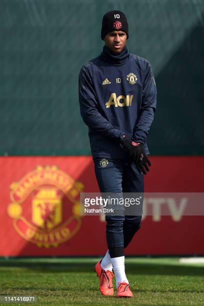 Marcus Rashford of Manchester United walks out to train during the Manchester United training session ahead of the UEFA Champions League Quarter...