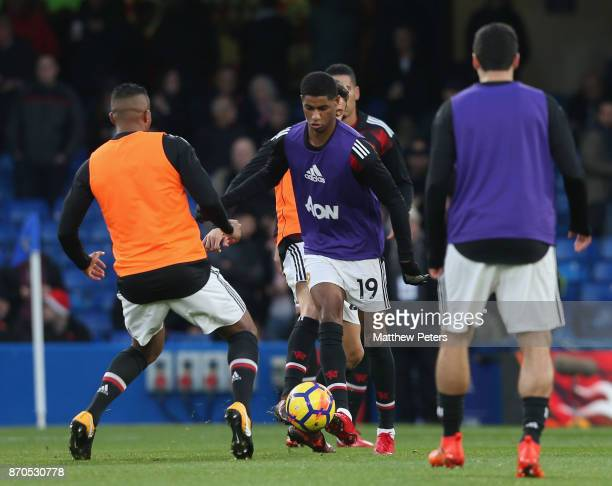 Marcus Rashford of Manchester United warms up ahead of the Premier League match between Chelsea and Manchester United at Stamford Bridge on November...
