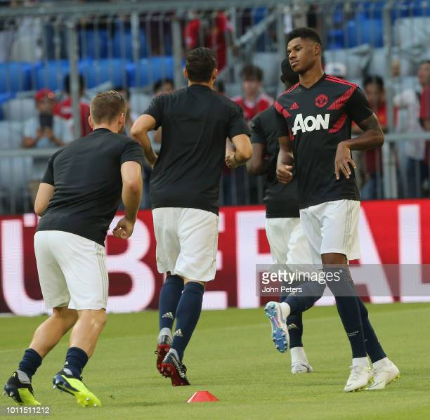 Marcus Rashford of Manchester United warms up ahead of the preseason friendly match between Bayern Munich and Manchester United at Allianz Arena on...