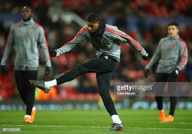 Marcus Rashford of Manchester United warms up prior to the UEFA Champions League Round of 16 Second Leg match between Manchester United and Sevilla...