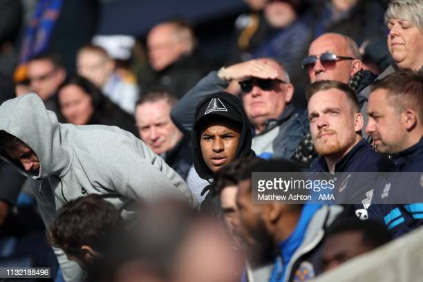Marcus Rashford of Manchester United watches the game during the Sky Bet League One match between Shrewsbury Town and Portsmouth at New Meadow on...