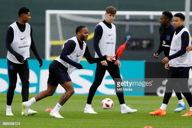 Marcus Rashford Raheem Sterling John Stones Danny Welbeck and Jesse Lingard play with toy rooster during an England training session ahead of the...