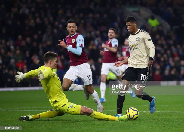Marcus Rashord of Manchester United goes round Nick Pope of Burnley FC to score his teams second goal during the Premier League match between Burnley...