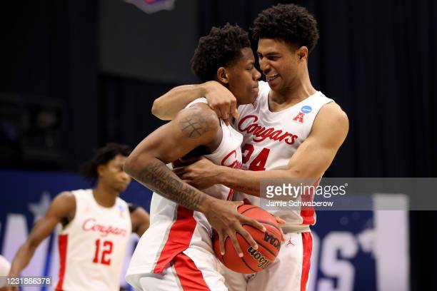 Marcus Sasser and Quentin Grimes of the Houston Cougars celebrate a victory over the Rutgers Scarlet Knights in the second round of the 2021 NCAA...