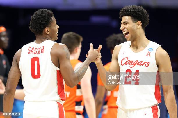 Marcus Sasser and Quentin Grimes of the Houston Cougars react in the second half of their Sweet Sixteen game against the Syracuse Orange in the 2021...