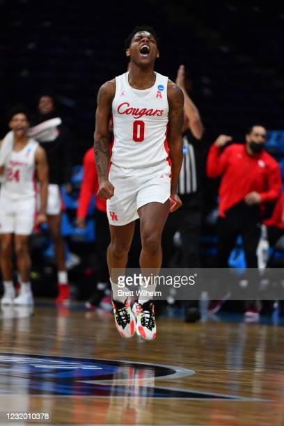 Marcus Sasser of the Houston Cougars celebrates during the Cougars game against the Oregon State Beavers in the Elite Eight round of the 2021 NCAA...
