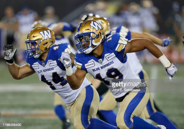 Marcus Sayles and Kyrie Wilson of the Winnipeg Blue Bombers cover apunt against the Hamilton Tiger-Cats at Tim Hortons Field on July 26, 2019 in...