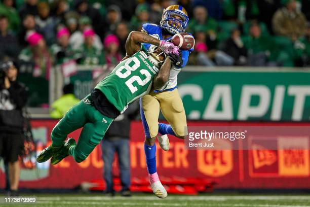 Marcus Sayles of the Winnipeg Blue Bombers is called for pass interference on a pass intended for Naaman Roosevelt of the Saskatchewan Roughriders in...