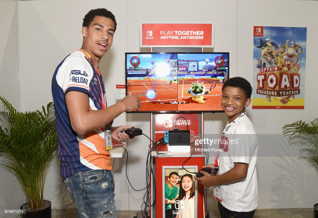 Marcus Scribner and Lonnie Chavis stop by the Nintendo booth at the 2018 E3 Gaming Convention for some hands-on time with the Mario Tennis™ Aces game for the Nintendo Switch system on on June 14, 2018 in Los Angeles, California.