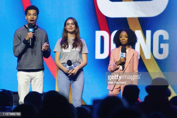 Marcus Scribner Bailee Madison and Skai Jackson speak on stage during WE Day at Tacoma Dome on April 18 2019 in Tacoma Washington