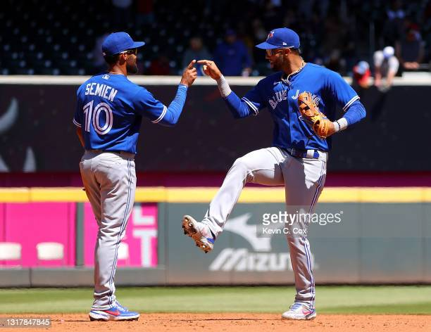 Marcus Semien and Lourdes Gurriel Jr. #13 of the Toronto Blue Jays celebrate their 8-4 win over the Atlanta Braves at Truist Park on May 13, 2021 in...