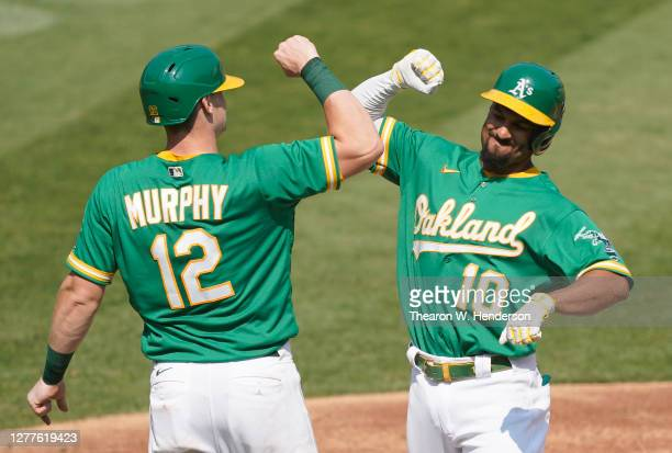 Marcus Semien and Sean Murphy of the Oakland Athletics celebrates after Semien hit a two-run home run against the Chicago White Sox during the second...