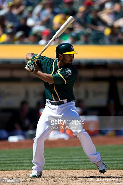 Marcus Semien of the Oakland Athletics at bat against the Los Angeles Angels of Anaheim during the sixth inning at Oco Coliseum on April 30 2015 in...