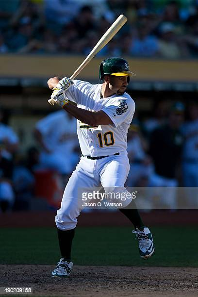 Marcus Semien of the Oakland Athletics at bat against the San Francisco Giants during the ninth inning at Oco Coliseum on September 26 2015 in...
