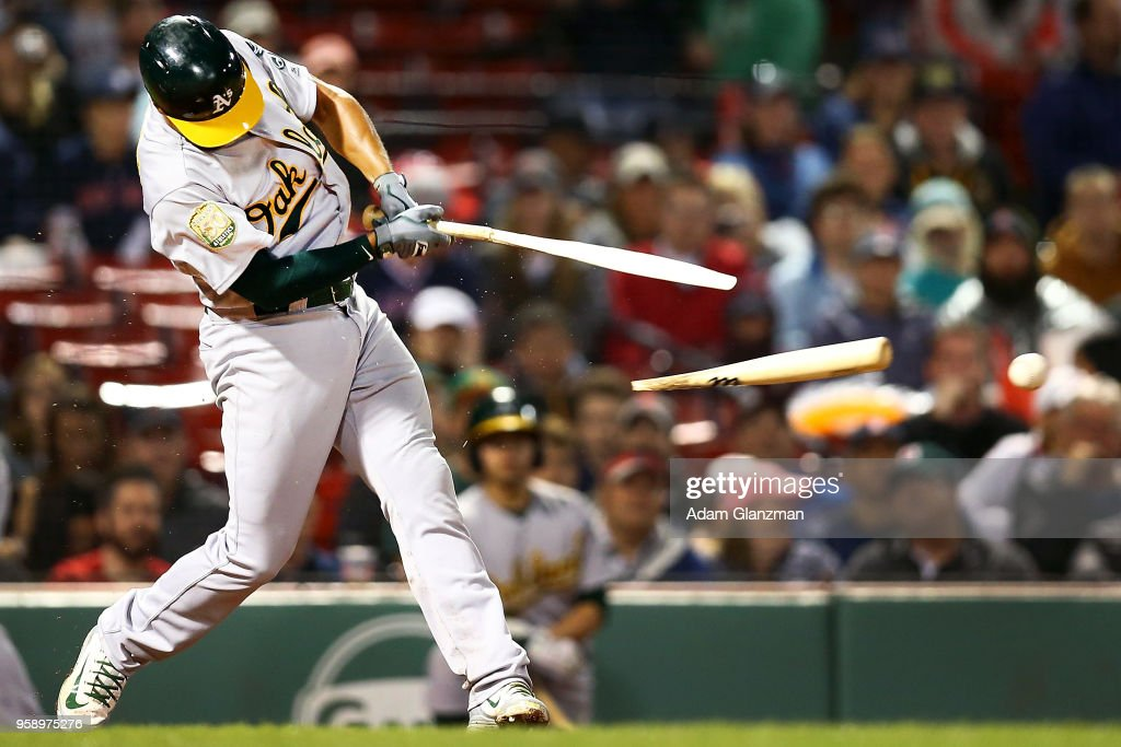 Marcus Semien #10 of the Oakland Athletics breaks his bat on a ground ball to third base in the fifth inning of a game against the Boston Red Sox at Fenway Park on May 15, 2018 in Boston, Massachusetts.